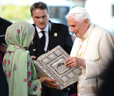 Pope Benedict receiving the Holy Koran